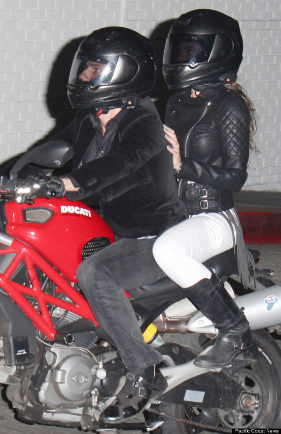 Actor Tom Cruise seen zooming off on a Ducati motorbike accompanied by an unknown women at a Chateau Marmont Party in West Hollywood